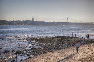 people by evening Lisbon beach city,