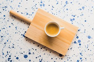 Cup of coffee on wooden board. Flat