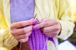 Knitting in female hands
