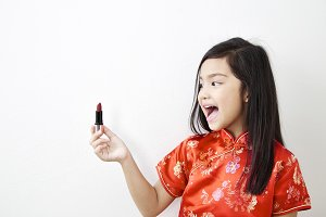 Little girl With red lipstick
