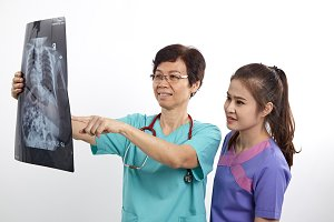 Doctor with nurse examining x-ray