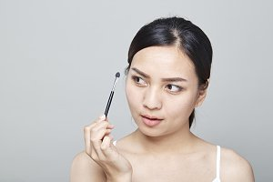 woman with cosmetics brush