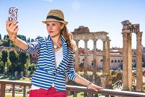 traveller woman in Rome taking selfi