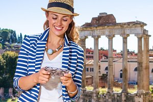 happy tourist woman in front of Roma