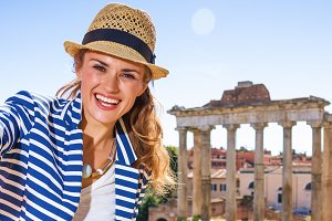 smiling tourist woman in front of Ro