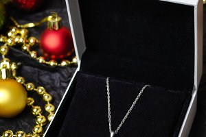 Silver necklace in gift box.