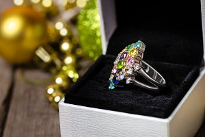 Silver ring in white gift box.