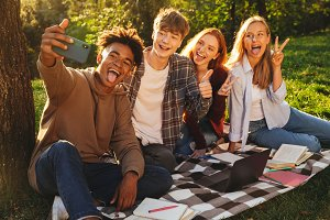 Group of delighted multhiethnic stud