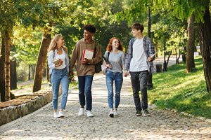 Group of happy student walking at th