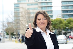 Business woman doing ok gesture. Suc