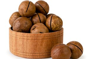 Macadamia nuts in wooden plate