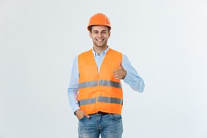 Happy young construction workers in