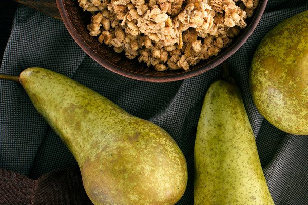 Food Stock Photos: LightField Studios - top view of crunchy granola and pear