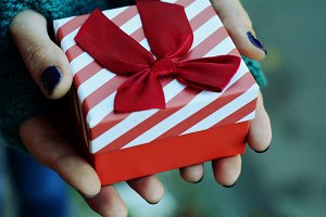 Female hands holding a gift box, pre