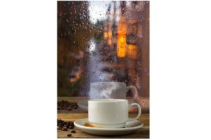 Cup of strong coffee on the rainy