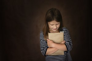 funny child girl with book in craft
