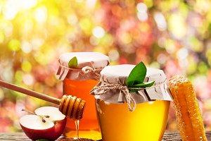 Jars full of fresh honey and honeyco