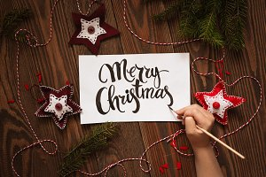 Happy Christmas lettering on sheet