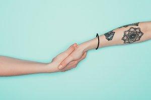 cropped shot of women shaking hands