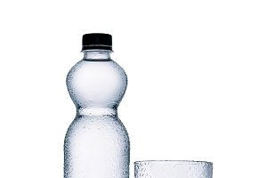 plastic bottle of water and empty gl