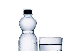 full plastic bottle of water and gla