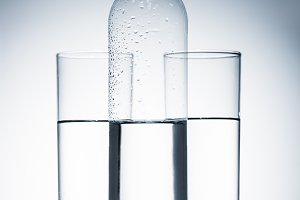 plastic bottle and glasses of clean