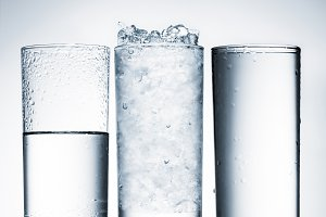 glasses of water in row and one with