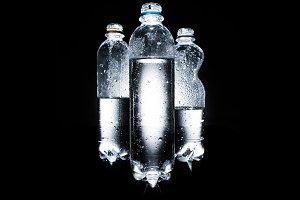 various plastic bottles of water on