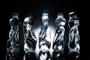 various crumpled plastic bottles of