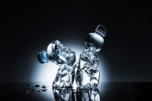 crumpled plastic bottles of water on