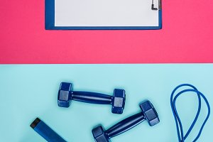 Sports dumbbells, clipboard and skip