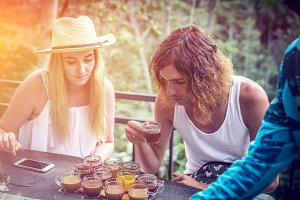 Young couple coffee and tea tasting