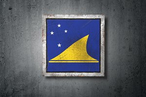 Tokelau flag in concrete wall