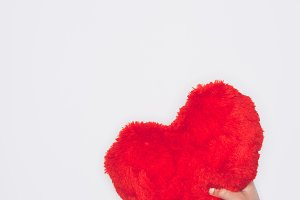 cropped shot of man holding red hear