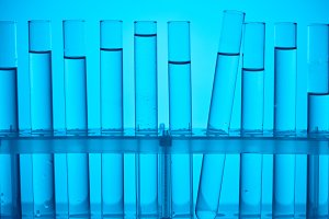 glass tubes on stand for chemical an