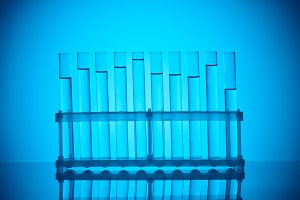 row of glass tubes with liquid on st