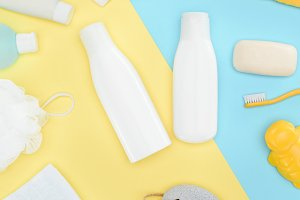 flat lay with body lotion in bottles
