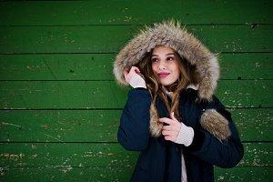 Beautiful brunette girl in winter wa