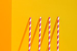 white and red striped straws standin