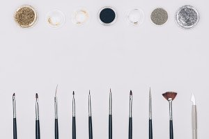 top view of brushes and glitter isol