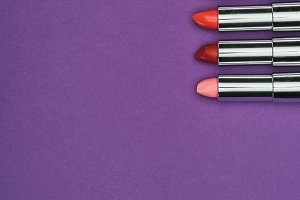top view of red and pink lipsticks i