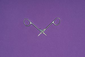 top view of scissors isolated on pur