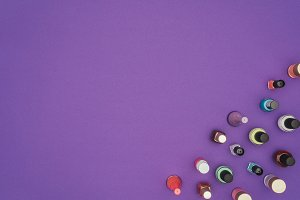 top view of colored nail polishes is