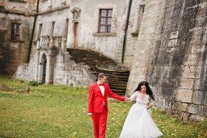 Beautiful wedding couple standing ou