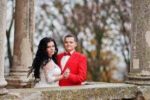 Good-looking wedding couple posing o