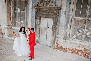 Lovely newlyweds dancing outdoor wit