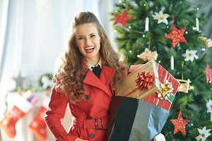 smiling modern woman with shopping b