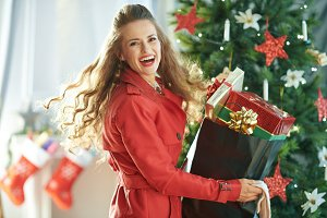 cheerful young woman with shopping b