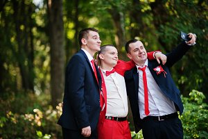 Handsome groom and his groomsmen pos