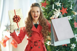 smiling young woman showing shopping